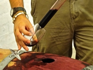 Extracting wine from the unopened 2015 barrel with a 'Wine Thief Tool'