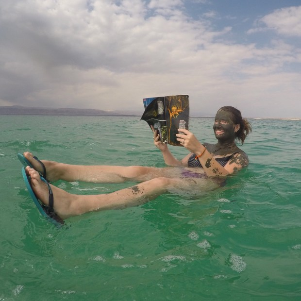 relaxing in Jordan sea covered in mud